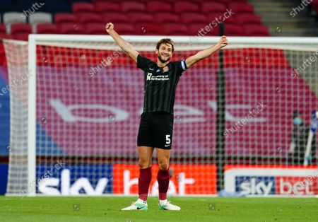 Northampton Town captain Charlie Goode celebrates at full-time as his side secure promotion to League One during the Sky Bet League Two Play off Final between Exeter City and Northampton Town