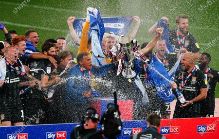 Northampton Town, including manager Keith Curle nd captain Charlie Goode, celebrate after beating Northampton Town 4-0 in the Sky Bet League Two Play off Final and securing promotion to League One.