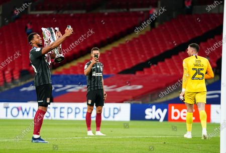 Vadaine Oliver of Northampton Town celebrates on the pitch after beating Exeter City 4-0 in the Sky Bet League Two Play off Final and securing promotion to League One.