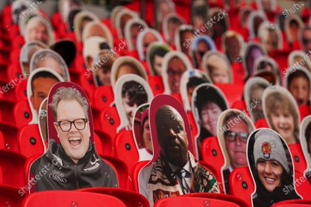 Faces on seats of Northampton Town fans, including Comedian Alan Carr and Basketball star Shaquille O'Neal, inside Wembley Stadium, before the SkyBet League 2 play off final between Exeter City and Northampton Town