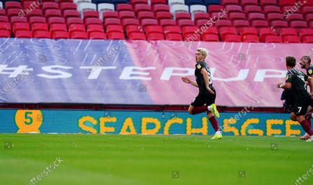 Ryan Watson of Northampton Town celebrates scoring the opening goal
