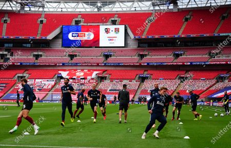 The Northampton team warm up inside Wembley Stadium, with Sky Bet and EFL branding, before the SkyBet League 2 play off final between Exeter City and Northampton Town