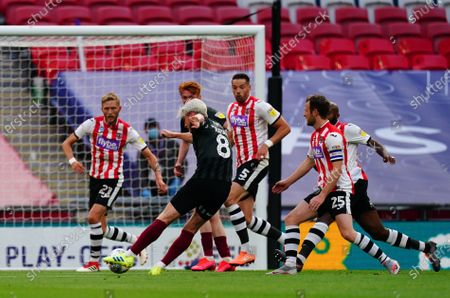 Ryan Watson of Northampton Town scories the opening goal during the League 2 Play Off final