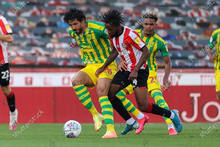 West Bromwich Albion defender Ahmed Hegazi (26) and Brentford midfielder Tariqe Fosu-Henry (24) clash over the ball during the EFL Sky Bet Championship match between Brentford and West Bromwich Albion at Griffin Park, London