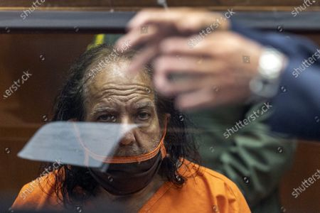 Stock Photo of Adult film star Ron Jeremy listens as his attorney Stuart Goldfarb speaks during his arraignment on rape and sexual assault charges at Clara Shortridge Foltz Criminal Justice Center in Los Angeles, California, USA, 26 June 2020. Jeremy, whose real name is Ronald Jeremy Hyatt, is charged with raping three women and sexually assaulting another in separate incidents between 2014 and 2019. The 67-year-old defendant could face up to 90 years to life in state prison if convicted as charged.