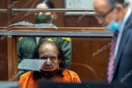 Adult film star Ron Jeremy listens as his attorney Stuart Goldfarb speaks during his arraignment on rape and sexual assault charges at Clara Shortridge Foltz Criminal Justice Center in Los Angeles, California, USA, 26 June 2020. Jeremy, whose real name is Ronald Jeremy Hyatt, is charged with raping three women and sexually assaulting another in separate incidents between 2014 and 2019. The 67-year-old defendant could face up to 90 years to life in state prison if convicted as charged.