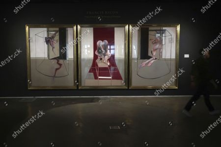 Painting by Francis Bacon titled 'Triptych Inspired by the Oresteia of Aeschylus' is on display at Sotheby's in New York, . The auction house projects the painting will sell for between $60 and $80 million during an online-only live stream video auction on Monday, June 29, 2020