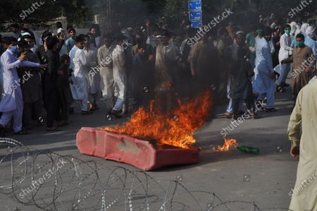 Police staff restored baton charge and fired tear gas shells to repel protesters moving towards the Red Zone area during a protest demonstration of citizens to condemn the inhuman and immoral attitude of police against Amir Tehkali in Peshawar on Friday. Demonstrators pelted stones at a police van on Friday as protests continued over a video of the Khyber Pakhtunkhwa (K-P) police brutality that went viral two days ago.