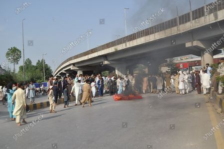 Stock Photo of Police staff restored baton charge and fired tear gas shells to repel protesters moving towards the Red Zone area during a protest demonstration of citizens to condemn the inhuman and immoral attitude of police against Amir Tehkali in Peshawar on Friday. Demonstrators pelted stones at a police van on Friday as protests continued over a video of the Khyber Pakhtunkhwa (K-P) police brutality that went viral two days ago.