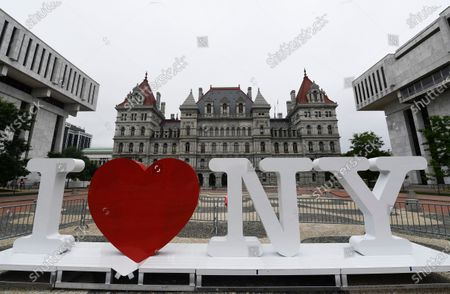 """Stock Image of A new promotional """"I Love NY"""" sign sits in the Empire State Plaza for installation in front of the New York state Capitol in Albany, N.Y. Milton Glaser, the designer who created the """"I (HEART) NY"""" logo and the famous Bob Dylan poster with psychedelic hair, died Friday, June 26, 2020, his 91st birthday"""
