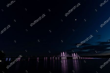Stock Image of Governor Mario Cuomo Bridge lit in honor of Pride Month and the LGBTQ community in colors of transgender flag per Governor Andrew Cuomo order. New York is the birthplace of the LGBTQ rights movement and in 2020 is 50th anniversary of the first Pride march in New York City.