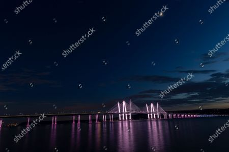 Governor Mario Cuomo Bridge lit in honor of Pride Month and the LGBTQ community in colors of transgender flag per Governor Andrew Cuomo order. New York is the birthplace of the LGBTQ rights movement and in 2020 is 50th anniversary of the first Pride march in New York City.