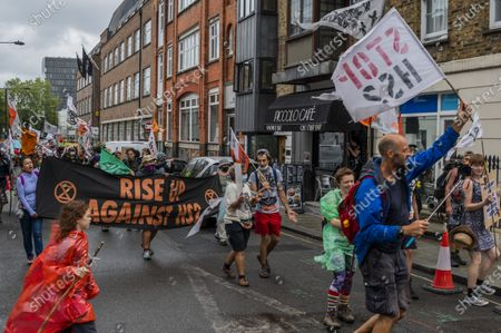 Stock Picture of The Extinction Rebellion Rebel Trail walkers and protest against HS2 arrives at the end of its journey, which involved walking along the proposed route. The eased 'lockdown' continues for the Coronavirus (Covid 19) outbreak in London.