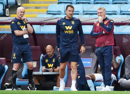 Aston Villa manager Dean Smith (R) and assistants John Terry (C) and Richard O'Kelly (L) during the English Premier League match between Aston Villa and Wolverhampton in Birmingham, Britain, 27 June 2020.