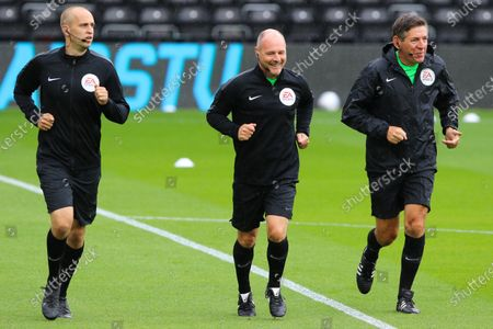 Referee Scott Duncan and assistants Robert Hyde and Andrew Garratt  ahead of the EFL Sky Bet Championship match between Derby County and Reading at the Pride Park, Derby
