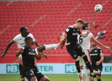 Leverkusen's Mitchell Weiser (3-R) and Danny Latza (2-R) of Mainz in action during the German Bundesliga soccer match between Bayer 04 Leverkusen and FSV Mainz 05 in Leverkusen, Germany, 27 June 2020.