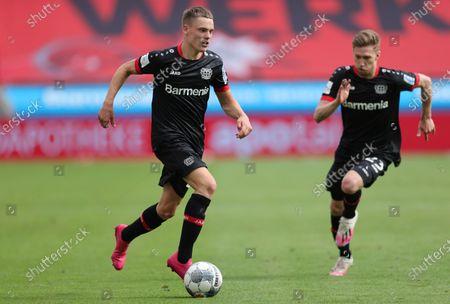 Leverkusen players Florian Wirtz (L) and Mitchell Weiser (R) in action during the German Bundesliga soccer match between Bayer 04 Leverkusen and FSV Mainz 05 in Leverkusen, Germany, 27 June 2020.