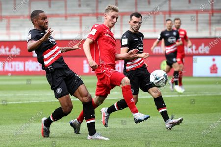 Mathias Jorgensen (L) and Kevin Stoger (R) of Fortuna Dusseldorf battles for the ball with Joshua Mees (C) of Union Berlin during the German Bundesliga soccer match between 1. FC Union Berlin and Fortuna Duesseldorf at Stadion An der Alten Foersterei in Berlin, Germany., 27 June 2020.