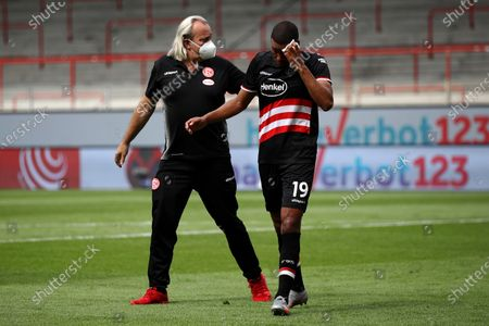 Mathias Jorgensen (R) of Fortuna Dusseldorf is treated by medical staff during the German Bundesliga soccer match between 1. FC Union Berlin and Fortuna Duesseldorf at Stadion An der Alten Foersterei in Berlin, Germany., 27 June 2020.