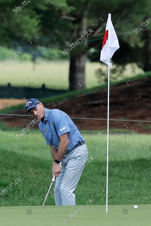 Jim Furyk putts on the seventh green during the third round of the Travelers Championship golf tournament at TPC River Highlands, in Cromwell, Conn