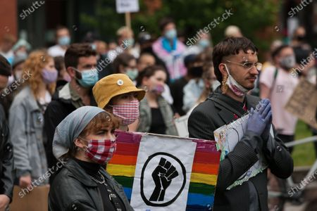People attend a Trans rights march in Manchester.