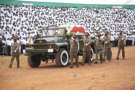 Military officers escort the coffin of late Burundian President Pierre Nkurunziza at his funeral in Gitega, Burundi, June 26, 2020. Late Burundian President Pierre Nkurunziza, who died in office of heart attack on June 8, was laid to rest on Friday at a state funeral in political capital Gitega, central Burundi.
