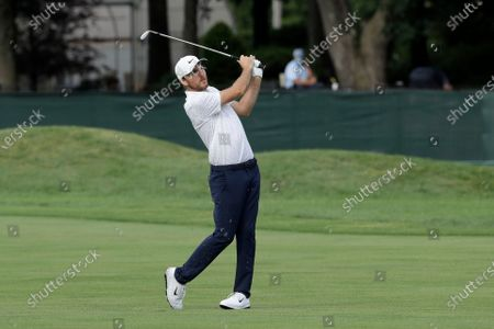 Russell Henley hits off the seventh fairway during the third round of the Travelers Championship golf tournament at TPC River Highlands, in Cromwell, Conn
