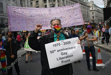 Peter Tatchell of the Gay Liberation Front holds a banner during a protest of former members of GLF in London, Britain, 27 June 2020. Former members of London's Gay Liberation Front are marking the organization's 50th birthday by marching the route of cancelled pride parade. The protest also supports Black Lives Matter movement and the LGBTQ+ people.
