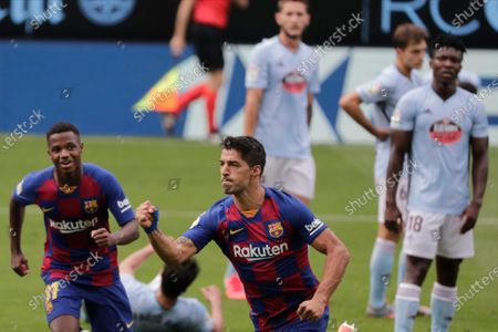 Barcelona's Luis Suarez, second left, celebrates after scoring his side's second goal during a Spanish La Liga soccer match between RC Celta and Barcelona at the Balaidos stadium in Vigo, Spain