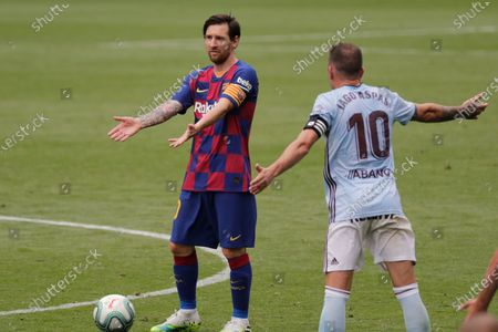 Barcelona's Lionel Messi gestures during a Spanish La Liga soccer match between RC Celta and Barcelona at the Balaidos stadium in Vigo, Spain