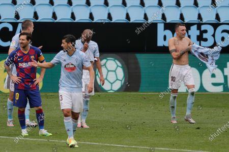 Celta Vigo's Iago Aspas, right, celebrates after scoring his side's second goal during a Spanish La Liga soccer match between RC Celta and Barcelona at the Balaidos stadium in Vigo, Spain