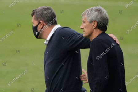 Celta Vigo's head coach Oscar Garcia Junyent, left, and Barcelona's head coach Quique Setien after the Spanish La Liga soccer match between RC Celta and Barcelona at the Balaidos stadium in Vigo, Spain