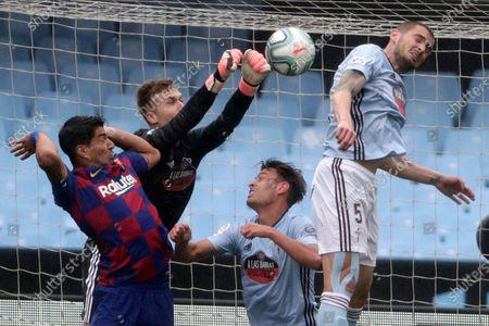 Celta Vigo's goalkeeper Ruben Blanco, second left, clears a ball during a Spanish La Liga soccer match between RC Celta and Barcelona at the Balaidos stadium in Vigo, Spain