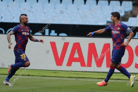 Barcelona's Luis Suarez, right, celebrates after scoring the opening goal during a Spanish La Liga soccer match between RC Celta and Barcelona at the Balaidos stadium in Vigo, Spain