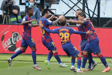 Barcelona's Luis Suarez, right, celebrates with teammates after scoring the opening goal during a Spanish La Liga soccer match between RC Celta and Barcelona at the Balaidos stadium in Vigo, Spain