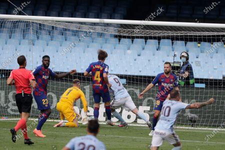 Celta Vigo's Smolov, third right, scores his side's first goal during a Spanish La Liga soccer match between RC Celta and Barcelona at the Balaidos stadium in Vigo, Spain