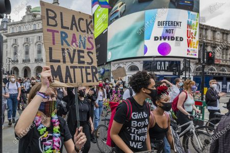 Passing Pride adverts on the Piccadilly Lights - London Trans+ Pride peaceful protest for Black Trans Lives Matter. The march was a demonstration against transphobic legislation proposed by the government, a commemoration of Black Trans lives that have been lost and a celebration of the Black Trans community.  Black Lives Matter protesters respond to the the death of George Floyd, in Minneapolis. The eased 'lockdown' continues for the Coronavirus (Covid 19) outbreak in London.
