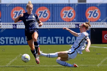 North Carolina Courage forward Kristen Hamilton (23) drives as Portland Thorns FC defender Becky Sauerbrunn (4) slides in with a challenge during the first half of an NWSL Challenge Cup soccer match at Zions Bank Stadium, in Herriman, Utah