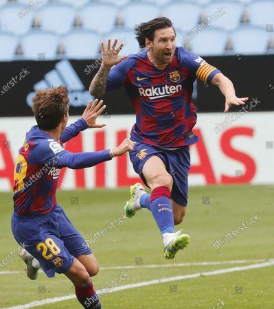FC Barcelona players Lionel Messi (R) and Riqui Puig (L) celebrate their team's 1-0 lead during the Spanish La Liga soccer match between Celta Vigo and FC Barcelona at Balaidos Stadium in Vigo, northern Spain, 27 June 2020.