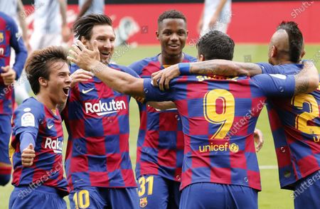 FC Barcelona's Luis Suarez (2-R) celebrates with teammates after scoring the 1-0 lead during the Spanish La Liga soccer match between Celta Vigo and FC Barcelona at Balaidos Stadium in Vigo, northern Spain, 27 June 2020.