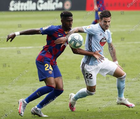 Stock Picture of Celta Vigo's Santi Mina (R) in action against FC Barcelona's Junior Firpo (L) during the Spanish La Liga soccer match between Celta Vigo and FC Barcelona at Balaidos Stadium in Vigo, northern Spain, 27 June 2020.