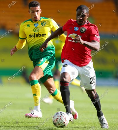 Odion Ighalo (R) of Manchester United in action against Ben Godfrey (L) of Norwich during the English FA Cup quarter final soccer match between Norwich City and Manchester United in Norwich, Britain, 27 June 2020.