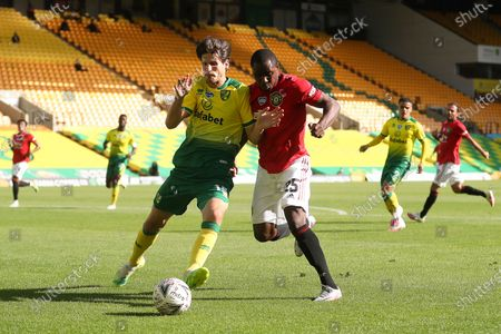 Odion Ighalo (R) of Manchester United in action against Timm Klose (L) of Norwich during the English FA Cup quarter final soccer match between Norwich City and Manchester United in Norwich, Britain, 27 June 2020.
