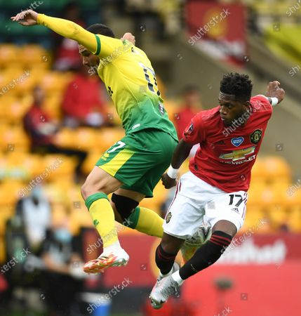 Emi Buendia (L) of Norwich in action against Fred (R) of Manchester United during the English FA Cup quarter final soccer match between Norwich City and Manchester United in Norwich, Britain, 27 June 2020.