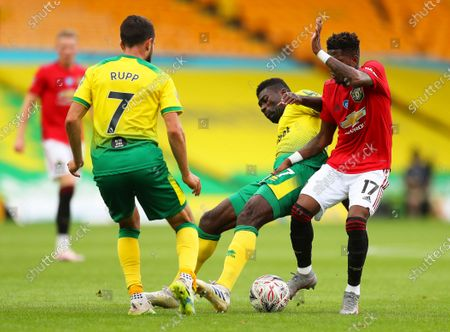 Fred (R) of Manchester United in action against Norwich players Alexander Tettey (C) and Lukas Rupp (L) during the English FA Cup quarter final soccer match between Norwich City and Manchester United in Norwich, Britain, 27 June 2020.