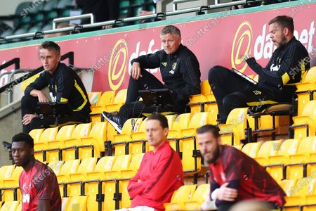Manchester United manager Ole Gunnar Solskjaer (up C) sits in the stands during the English FA Cup quarter final soccer match between Norwich City and Manchester United in Norwich, Britain, 27 June 2020.