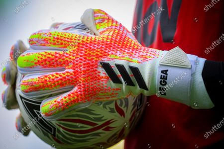 Manchester United goalkeeper David de Gea holds the match ball prior to the English FA Cup quarter final soccer match between Norwich City and Manchester United in Norwich, Britain, 27 June 2020.