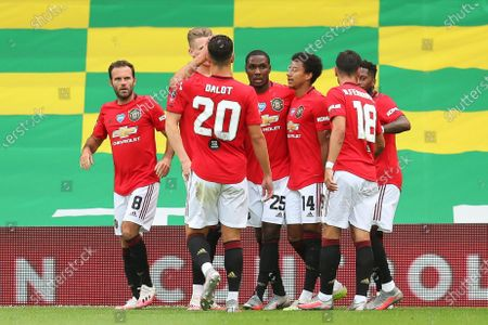 Odion Ighalo (C) of Manchester United celebrates with teammates after scoring the 1-0 lead during the English FA Cup quarter final soccer match between Norwich City and Manchester United in Norwich, Britain, 27 June 2020.
