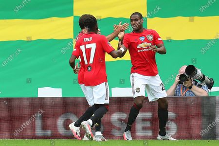 Odion Ighalo (R) of Manchester United celebrates with teammates after scoring the 1-0 lead during the English FA Cup quarter final soccer match between Norwich City and Manchester United in Norwich, Britain, 27 June 2020.