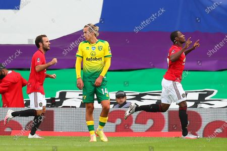 Odion Ighalo (R) of Manchester United celebrates after scoring the 1-0 lead during the English FA Cup quarter final soccer match between Norwich City and Manchester United in Norwich, Britain, 27 June 2020.